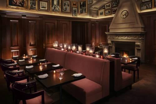 new-york-edition-luxury-hotel-dining-fireplace - Kennedy Airport JFK